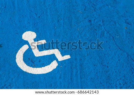 White disabled parking sign painted on blue background #686642143