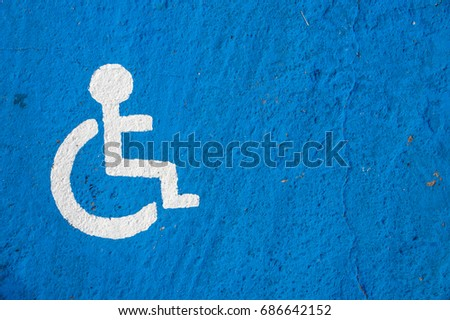 White disabled parking sign painted on blue background #686642152