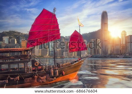 Vintage sail boat fron victoria port to Hongkong harbour for survice to tourist in Hong kong coty with sunset and blue sky, China, Travel asia and cityscape concept Royalty-Free Stock Photo #686676604