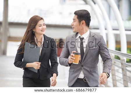 People walking and talk togetherat outdoor place, Woman follow businessman for work. #686679877