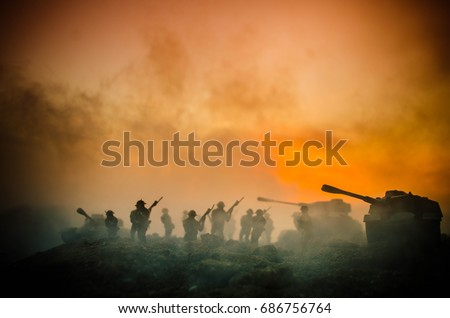 War Concept. Military silhouettes fighting scene on war fog sky background, World War Soldiers Silhouettes Below Cloudy Skyline At night. Attack scene. Armored vehicles. Tanks battle. Decoration #686756764