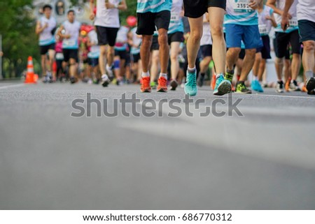 Group of people running race marathon. #686770312