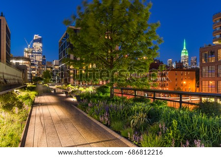 High Line promenade at twilight with city lights and illuminated skyscrapers. Chelsea, Manhattan, New York City #686812216