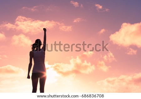 Woman, power, and victory concept.  Royalty-Free Stock Photo #686836708