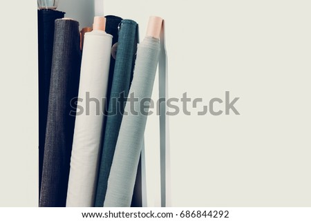 Rolls of natural high fashion fabrics and textiles. Sewing industry concept Royalty-Free Stock Photo #686844292