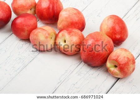 Ripe red peaches on the white wooden table, soft focus background #686971024