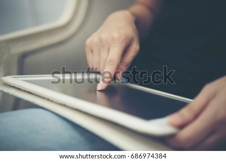 Close up man hands using tablet sitting and relaxing. #686974384