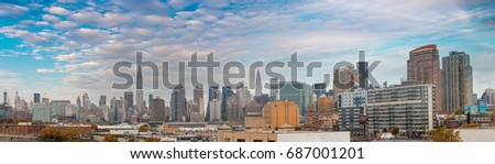 Midtown Manhattan eastern side panorama. Wonderful hi-res view from Brooklyn on a cloudy day.