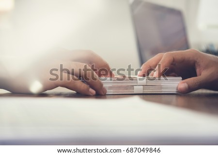 Close up of businessman hand giving money, Russian banknotes, to his partner on the table - loan, bribery and corruption concepts Royalty-Free Stock Photo #687049846