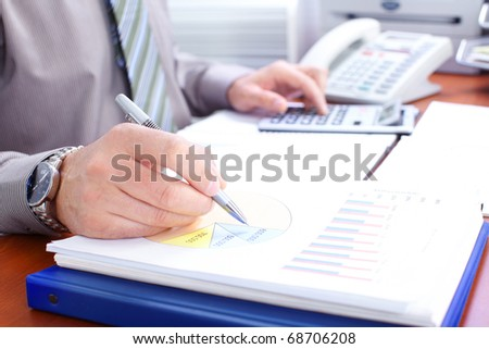 Businessman working with documents in the office #68706208