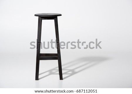 Studio shot of classic black tall wooden barstool standing on white #687112051