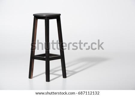 Studio shot of classic black tall wooden barstool standing on white #687112132