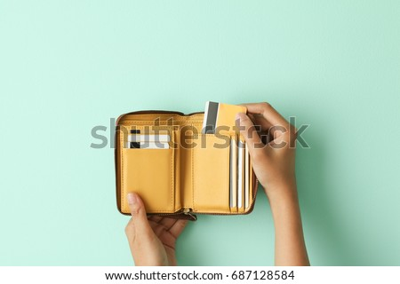 Hand holding wallet take out credit card Royalty-Free Stock Photo #687128584