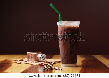Ice cocoa soft drink on wood floor and topping #687191131