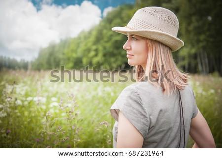 Portrait of beautiful woman in summer meadow outdoor  #687231964