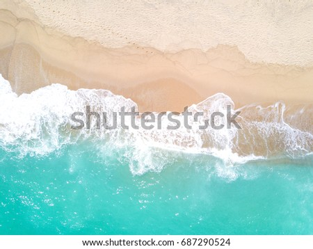 Aerial view of sandy beach and ocean with waves #687290524