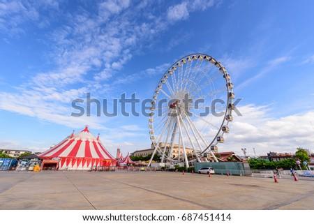 Ferris wheel in amusement park Royalty-Free Stock Photo #687451414