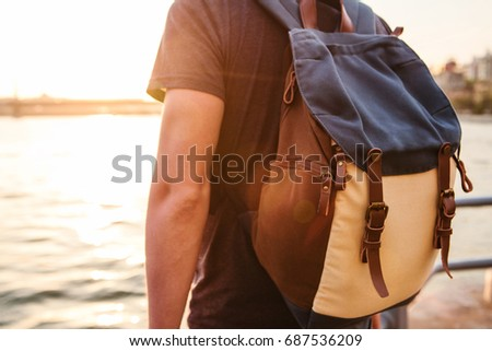 Male tourist with a backpack at sunset next to the Bosphorus in Istanbul. The concept of leisure, hiking, vacations. #687536209