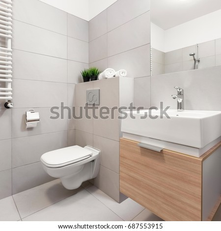 Bathroom with toilet, mirror and modern basin cabinet #687553915