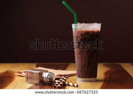 Ice cocoa soft drink on wood floor and topping #687627325