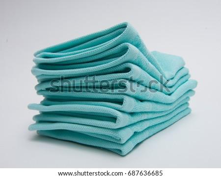 Folded light blue towels #687636685