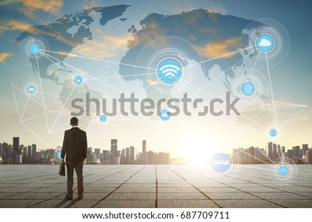 International business concept with businessman on city skyline background with network on map and sunlight #687709711
