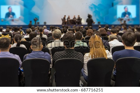 Speakers on the stage with Rear view of Audience in the conference hall or seminar meeting, business and education about investment concept Royalty-Free Stock Photo #687716251