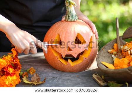 carve pumpkins for Halloween Royalty-Free Stock Photo #687831826