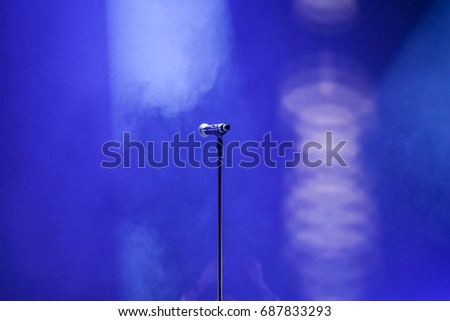 Microphone in colorful stage lights #687833293