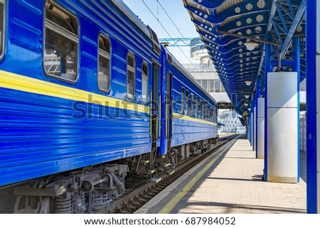 The blue train cars at the station waiting for departure #687984052