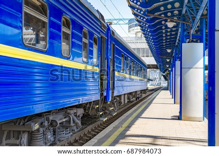 The blue train cars at the station waiting for departure #687984073