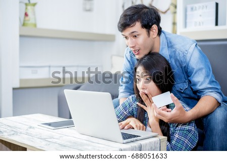 Lover are surprising when using the laptop and holding the credit card. Family concept, Lovers concept, Technology concept #688051633