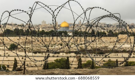 Dome of the Rock through barbed wire in Old Jerusalem, Israel. #688068559