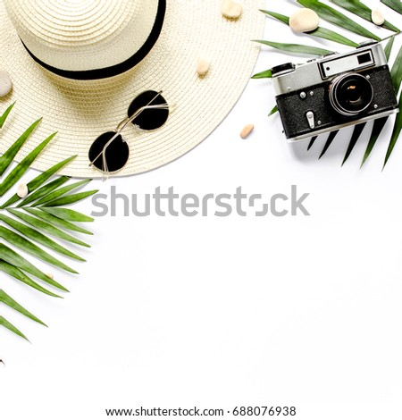 Traveler accessories, tropical palm leaf branches on white background with empty space for text. Travel vacation concept. Summer background. Road frame set. Flat lay, top view. #688076938