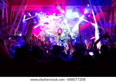Crowd at concert and blurred stage lights #688077208