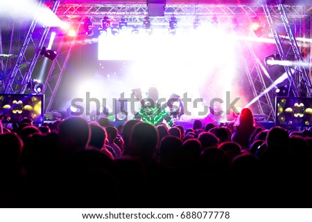 Crowd at concert and blurred stage lights #688077778