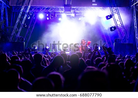 Crowd at concert and blurred stage lights #688077790