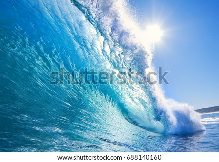 ocean-view seascape landscape Big surfing ocean wave with slightly cloudy sky and the sun #688140160
