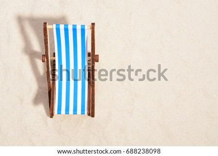 Top view of wooden beach chair on beach. #688238098