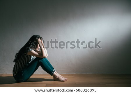 young pretty depression woman love broken sitting on wooden floor crying and feeling sadness screaming in white wall background. #688326895