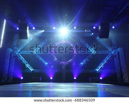 Empty Runway Fashion Show catwalk with moving beam lighting along walk way, background stage ramp Royalty-Free Stock Photo #688346509