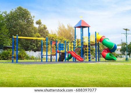 Colorful playground on yard in the park. Royalty-Free Stock Photo #688397077