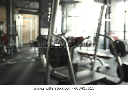 Abstract Blurred Fitness gym with bright tone background #688415515