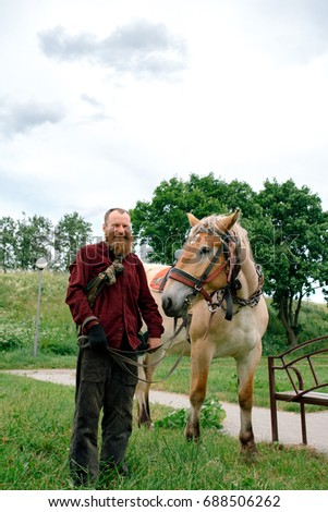 man and horse  #688506262