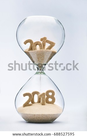 New Year 2018 concept with hourglass falling sand taking the shape of a 2018 #688527595
