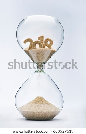 New Year 2019 concept. Time running out concept with hourglass falling sand from 2018. #688527619
