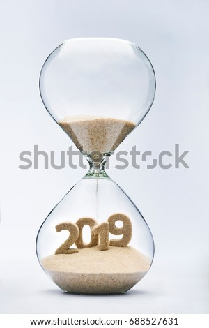 New Year 2019 concept with hourglass falling sand taking the shape of a 2019 #688527631