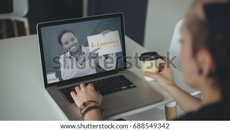 Digital composite of Woman using a computer with e-learning information in the screen #688549342