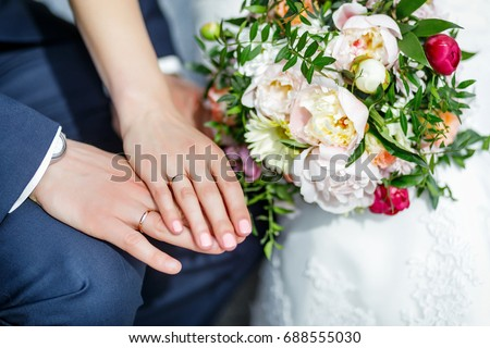 Wedding details. Hands of the newlyweds. Bride rings on hands. #688555030