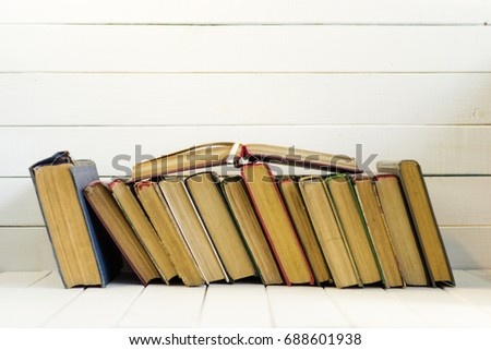 Open book on an white wooden table. Beautiful background. #688601938